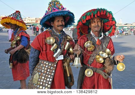 Marrakesh, Morocco - march 15, 2012: Typical water carriers in the Jemaa el Fna square