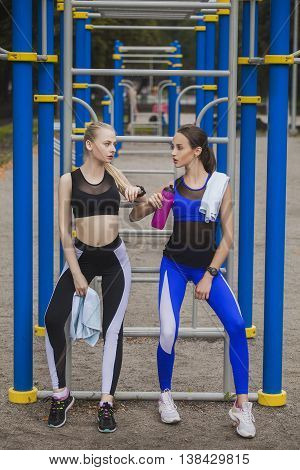 Two girls resting after exercise and prepare for competition