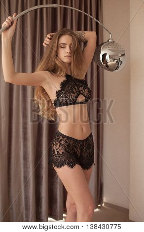 Sexy young brunette woman in black lingerie