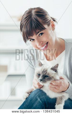 Woman Caressing Her Birman Cat