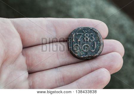 The coin collector found an ancient coin