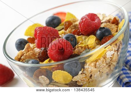 bowl of cereals and berry fruit - detail