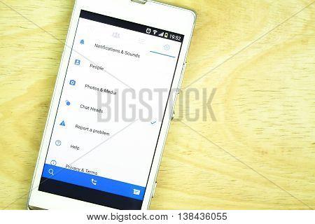 BUNG KAN THAILAND - JANUARY 15 2016: smart phone display facebook messenger app on office desk