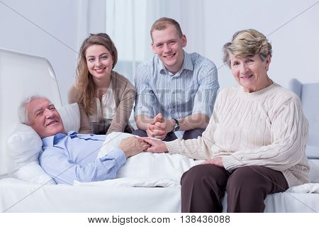 Taking Good Care Of Their Beloved Grandpa