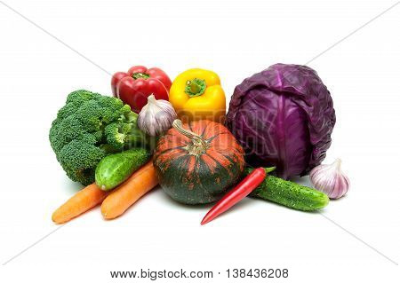 pumpkin and other vegetables on a white background. horizontal photo.