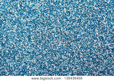 Horizontal vivid blue pebble grainy sand textured abstract background backdrop