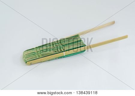 Fan made of palm leaves ancient nature on white background. (Select focus)