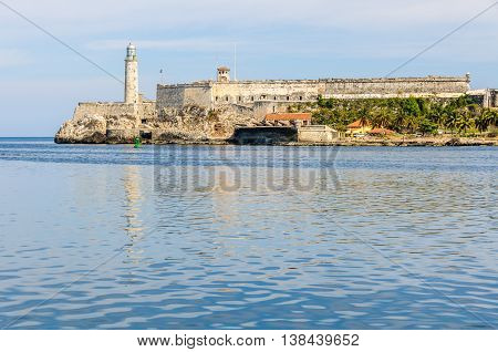 The reflection of Morro Castle in Havana the capital of Cuba