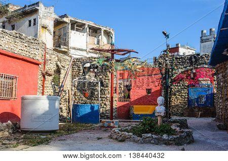 HAVANA, CUBA - MARCH 17, 2016: Callejon de Hamel an alley full of art works made from trash in Havana the capital of Cuba