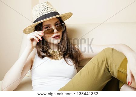 pretty young woman wearing sunglasses and summer hat, fashion people concept real hipster