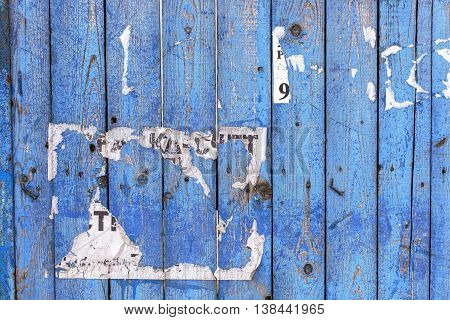 Old shabby wooden fence background with a trace of ads.