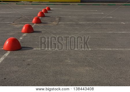 Hemispheres are mounted on a supermarket parking.