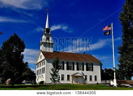 Rindge New Hampshire - July 11 2013: The white wooden colonial 1796 Second Rindge Meeting House and Town Hall overlooking the Village Green