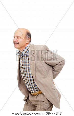 Elderly man holds on lower back and wincing.