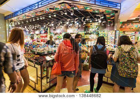HONG KONG CHINA - OCT 23: People shopping souvenir on market of The peak on october 23 2015 in Hong Kong. Offers breathtaking views of the harbour and city. This is Hong Kong's must-see.