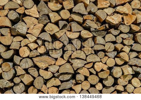 Professional pile of cut firewood as a background