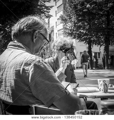 HELSINKI, FINLAND . JULY 11: Senior citizens sitting and drinking coffee in a café in Helsinki at July 11, 2016