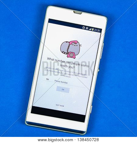 BUNG KAN THAILAND - FEBRUARY 19 2016: smart phone display facebook messenger app on blue background space for caption