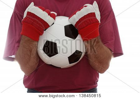 man takes a leather ball in hands