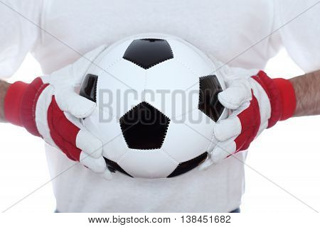 classical soccer ball in hands on white background