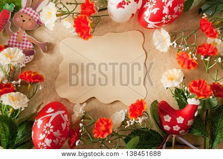 Frame with colorful flower decoration and eggs