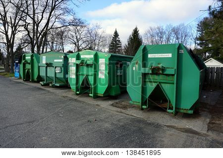 HARBOR SPRINGS, MICHIGAN / UNITED STATES - DECEMBER 25, 2015: Green bins are available in Harbor Springs for people to bring their recyclable materials.