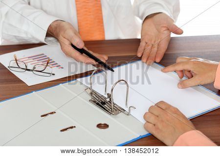 working team with documents and diagram on table