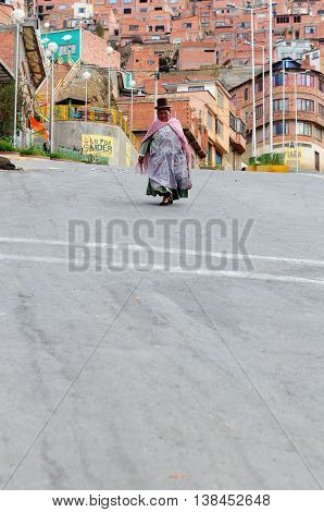 LA PAZ BOLIVIA - OCTOBER 27: The woman in the ethnic dress is going along steep streets of the capital city of Bolivia of the city La Paz in South America in October 27 2011