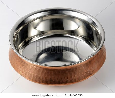 Empty Indian bowl of steel and copper