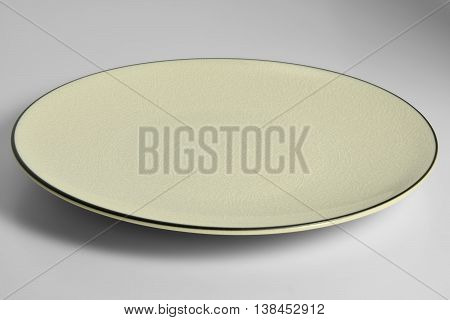 Empty Yellow enameled plate with chapped effect with black border