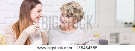 Girl And Intergenerational Talks With Grandmother