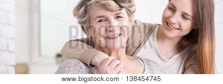 Woman Embracing Lovely Grandmother