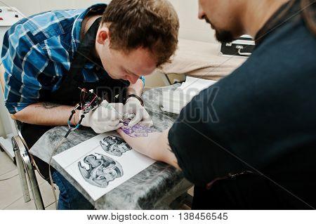 Tattoo Master Make Tattoo For Rocker Man At Tattoo Salon