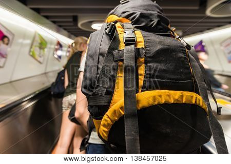 Young Tourist Student With A Bagpack In Subway For Travel