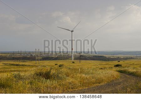 The big wind generator installed in the field of Donbass develops the electric power