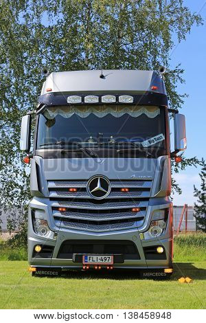 PORVOO, FINLAND - JULY 2, 2016: Silver Mercedes-Benz Actros truck on display on the annual Riverside Truck Meeting 2016.