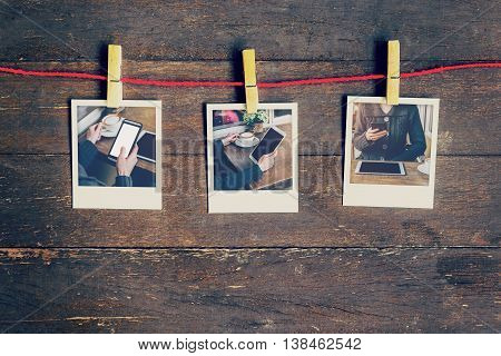 Frame Photos Woman Using Phone Set Hanging On Clothesline And Wooden Background. Vintage Filtered.