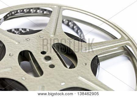 Vintage film strip and wheel on white background