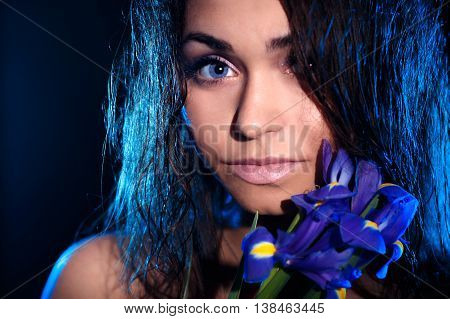 Woman With A Blue Flower Of Iris