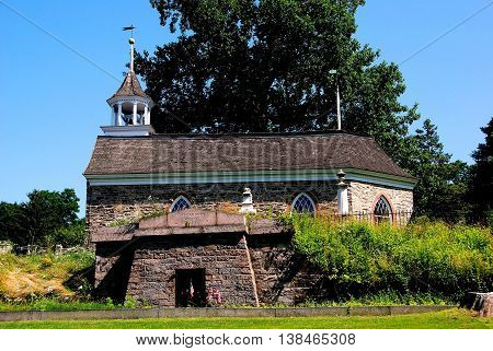 Sleepy Hollow NY - July 9 2009: Mausoleum vault and 1685 Old Dutch Church of Sleepy Hollow