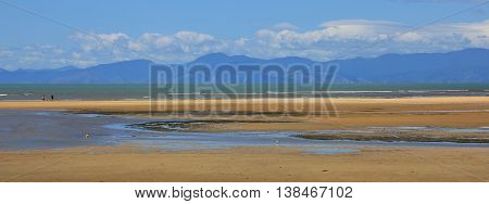 Beach at low tide in Marahau New Zealand.