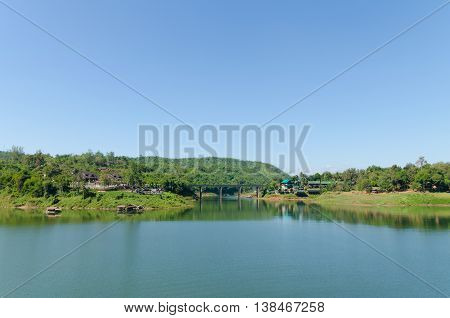 Lake with bridge in Kanchanaburi Thailand landscape