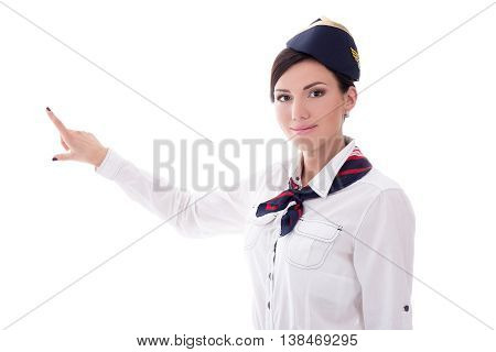 Portrait Of Stewardess In Uniform Pointing At Something Isolated On White