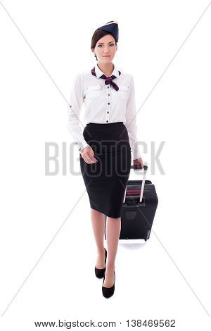 Front View Of Young Stewardess Walking With Suitcase Isolated On White