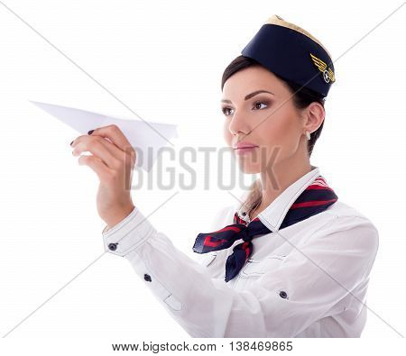 Portrait Of Young Stewardess Holding Paper Plane Isolated On White