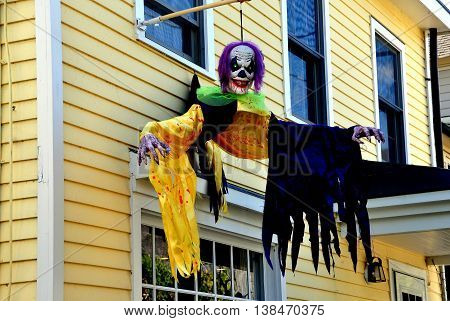 Cold Spring NY - October 17 2014: A scary Halloween decoration hangs fron a 19th century wooden house on Main Street in the Lower Village