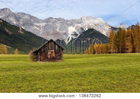 Autumn rural scenery of Miemenger Plateau with rocky mountains peaks in the background. Austria Europe Tyrol.