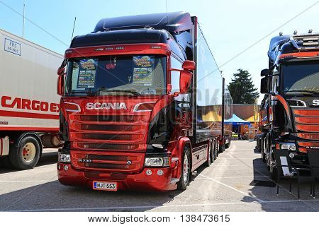 PORVOO FINLAND - JULY 2 2016: Beautiful new red and black Scania R730 truck and full trailer on the annual Riverside Truck Meeting 2016.