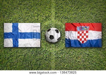 Finland Vs. Croatia Flags On Soccer Field