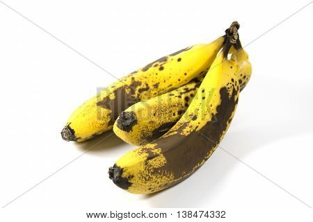 Over ripe banana and skin on white background